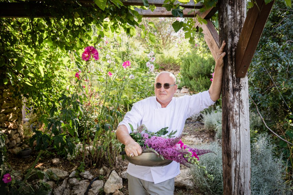 Master chef Erez Komarovsky harvests a bouquet of flowers to weave into his challah bread.
