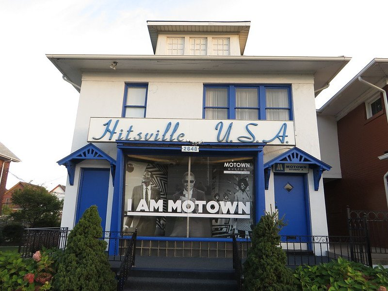 """Hitsville, USA, aka the Motown Museumis one of our favorite fun things to do in Detroit. This Ken Lund photo shows the famous and modest 2-story building with its iconic brilliant blue doors and script title, and features photos of Motown legends Marvin Gaye, Stevie Wonder, and Diana Ross behind the caption """"I Am Motown."""""""