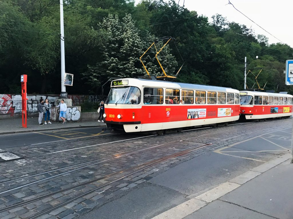 A bright red train, part of Prague's transportation system, and a great aid to sightseeing Prague.