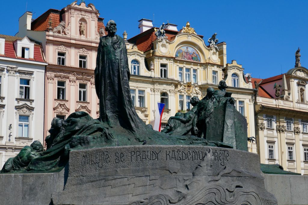 Czech hero Jan Hus glares down from atop his monument in Wenceslaus Square