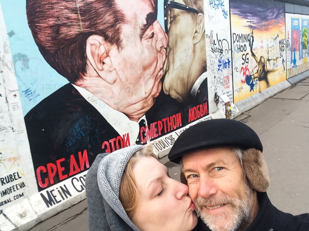Recreating the Brezhnev Honecker smooch in front of what's left of the former Berlin Wall