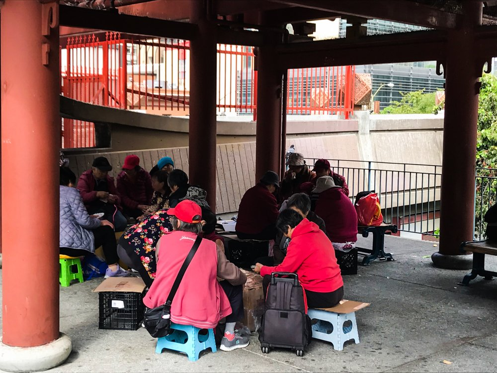 a group of women play cards in St. Mary's Square, Chinatown, San Francisco
