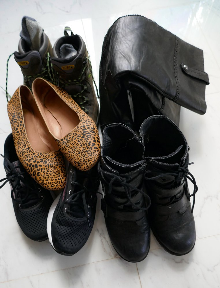 With the luxury of added space, our road trip packing list includes more shoes than we'd take on the plane: Boots for walking around town, hiking, and tall dressy boots to wear out on the town, as well as cute leopard print flats and workout sneakers.
